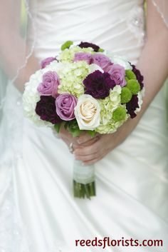 Beautiful purple and pink bouquet. Pretty in any season. Designed exclusively by our highly experienced designers for our bride. reedsflorists.com