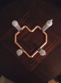 Heart Shaped Copper Candle Holder, Home or Wedding Decor, Mothers Day Candelabra, Romantic Centerpiece Anniversary Wedding. $93.35 AUD     Handmade item     Materials: copper, flux, fire, passion, creativity, metal, solder, copper pipe, copper fittings, repurposed copper     Made to order     Feedback: 2 reviews
