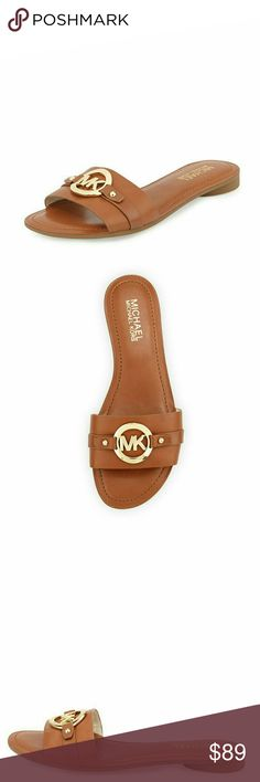 New! MICHAEL KORS MK Logo Molly Slide Sandals The easy, slide-on design of the Michael Kors Molly slide makes it a perfect pair to your spring and summer wardrobe. The signature logo hardware and smooth Vachetta leather complete the look.  Brand New With Box  Color: Luggage  Logo buckle at center with logo hardware  Slip-on style  Leather upper  Leather lining  Wide strap band vamp  Open toe and back  Logo stamped rubber sole  0.75 inch round heel Michael Kors Shoes Sandals