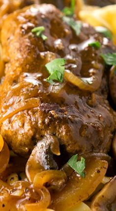 Salisbury Steak with mushrooms and onions served with gravy over noodles or rice ~ comfort food at its finest... a classic, and so easy to make!