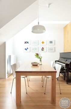 Amongst the sea of timber, a piano provides a slick focal point, and ensures the home is filled with music.