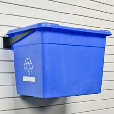 a bin might be the solution for extension cords.  New Age Products - The Organized Garage