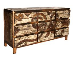 This nine-drawer dresser displays understated creativity and whimsical charm. The unexpected combination of upcycled hardwood, rippled carving and weathered paint makes you think of driftwood on the shore or gnarled mangroves holding together a tropical ecosystem. With plenty of space to hide your clutter, this dresser can be used to store clothing in a bedroom or linens and silverware in a dining room. Price $2,200.00
