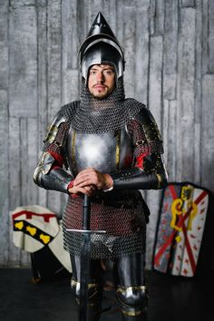 Full-plate armour of the XIV century in Churburg style with decorative brass strips