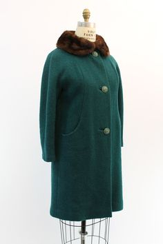 A cozy winter coat, done in an incredible color! Vintage 1960s wool boucle swing coat. Done in a gorgeous spruce colored wool. Soft brown mink
