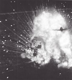 An explosion of an ammunition train somewhere in Europe, caught on film by a pilot's jerry-rigged camera, during an attack by a group of P-47 Thunderbolts.