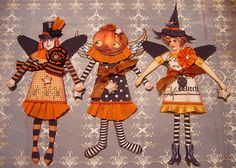 HALLOWEEN PAPER DOLLS    The paper dolls were made with a digital collage sheet from www.cassiscreations.etsy.com