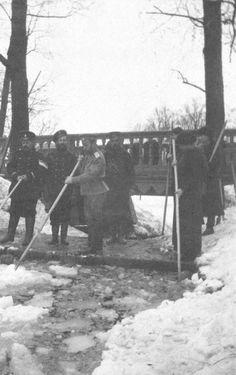 Nicholas & OTMA breaking ice at Tsarskoe Selo 1917. Provisional soldiers standing guard.