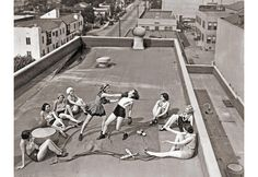 Although this photo looks like a real boxing match of women in 1938, its most likely staged. The fact that all the women pictured are wearing dance shoes is a give away that they may be practice a science for a show. In the 1930's there wasn't decent air conditioning so it was common for performers to practice outside or on roofs instead of inside hot theaters.