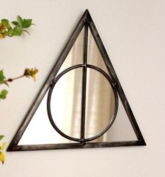 this is from Harry potter. I didn't even read Harry potter and I knew this! ~ Triangle Circle Wall Mirror Geometric / Handmade Wall by fluxglass Deco Harry Potter, Harry Potter Bedroom, Harry Potter Houses, Harry Potter Mirror, Harry Potter Bathroom Ideas, Harry Potter Library, Harry Potter Symbols, Handmade Wall Mirrors, Potters House