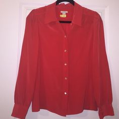 BCBGMAXAZRIA Red Silk Blouse Red silk blouse. Photo 3 shows tiny stain. May be able to get out if treated. Buttons down the center as well as around the wrists. BCBGMaxAzria Tops Blouses