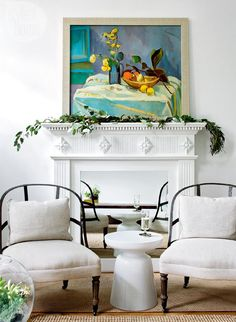 Love both the painting and the mirror over the fireplace opening.