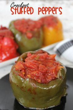 """No-Fuss Slow Cooker Stuffed Peppers take tender, slow cooked bell peppers and stuff them with an ultra flavorful filling. The slow cooker does all the work for you; no browning beef or boiling rice required! Easy Stuffed Peppers, Slow Cooker Stuffed Peppers, Pork Recipes, Slow Cooker Recipes, Crockpot Recipes, Cat Recipes, Slow Cooking, Spaghetti Sauce From Scratch, Bruschetta Chicken Pasta"