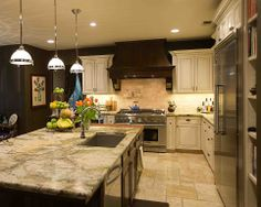 Traditional Kitchen - Find more amazing designs on Zillow Digs!   Like the dark/light combination with marbled counters