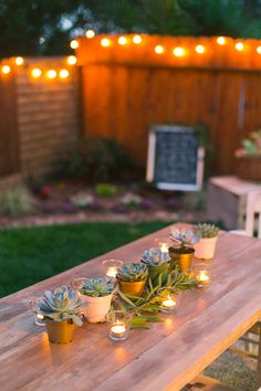 Succulents and tea lights for outdoor dining