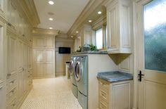 Since I do 4 to 6 loads of laundry a day, I feel confident that my hubby will allow me this beautiful laundry room.  Isn't it fun to live in a fantasy world!  LOL