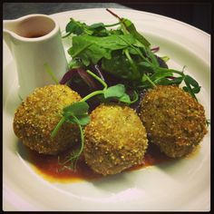 Arancini al prosciutto, porcini e scamorza affumicato. Risotto balls stuffed with shredded ham hock, porcini mushrooms and smoked scamorza cheese, deep fried and served with pizzaiola sauce.