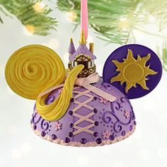 Disney Rapunzel Ear Hat Ornament | Disney StoreRapunzel Ear Hat Ornament - The artistic Disney Princess brings her signature style to this Rapunzel Ear Hat Ornament. Created by Disney artist Cody Reynolds, this detailed ornament features the <i>Tangled</i> star's golden hair, tower and sparkling rhinestones.