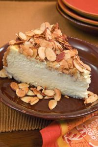 Amaretto Cheesecake- I have attempted variants of this before. Will need to try this specific recipe. I used to eat at an Italian place that had the best Amaretto Cheesecake ever! No Bake Desserts, Just Desserts, Delicious Desserts, Dessert Recipes, Yummy Food, Yummy Yummy, Amaretto Cheesecake, Cheesecake Recipes, Gourmet