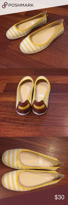 Nine West Flats NWOT These are a brand new pair of Nine West Flats in yellow and white. The soles has a criss cross design that can be seen in the photos. The back has a leather detail with a yellow strape. Please let me know is you have any questions. Thanks Nine West Shoes Flats & Loafers