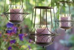 Garden Sanctuary Hanging Lantern - Sweeping weathered arches curve gracefully to form a fanciful metal lantern with Victorian flair. Looks breathtaking with an Escential or GloLite by PartyLite® Jar, tealights or large tealights, all sold separately.