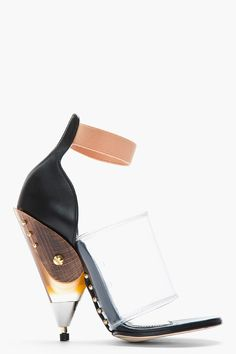 We already reported on this season's must have trend: transparency, with a special shout out to our current object of desire, the shoe of the season, Givenchy's black and transparent Albertina Podium heels