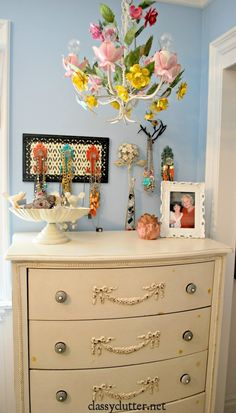 I would love a dresser like this with a mirror on the wall...and hooks or the sides