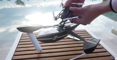 Well, here's a fun surprise! Parrot has just revealed a pile of inexpensive new minidrones, 13 in all, including one that tackles a new medium: water.  The hybrid UAV/Boat is called the Hydrofoil Drone, and is joined by a couple of new 'Jumping' drones and a new flying model, the 'Airborne.'