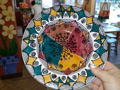 This is a salad bowl made of pottery that's been painted and fired.