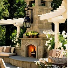 Outside living...added to an outdoor kitchen. Love the large seating area in front of the fireplace.