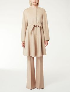 MAXMARA | Double layered pure cashmere coat with raglan sleeves and a flared line on the bottom. The hand made detail, which combines two layers of fabric, means that the garment has no need of a lining. Pockets on the sides. Matching belt | Product name:  PRISMA | Product code: 1086075506002 | Colour: Beige-cammello | €2,300