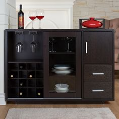 Sleek and modern, this contemporary dining buffet server makes a great addition to any dining space. This piece boasts a built-in wine cabinet to accommodate up to 16 standard size wine bottles, with glass-front doors to create a beautiful display. A secondary cabinet, 2 drawers on double metal glides, and three spacious open shelves provide ample room for dining storage and organization. With metallic hardware detail.