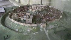 Old Sarum, England. This is a model reconstruction of the Medieval castle of Old Sarum. Originally an ancient Iron Age hill fort, Old Sarum became one of the most important Medieval castles in England (built over the massive earthworks of the ancient hill Medieval Castle, Medieval Fantasy, English Architecture, Castles In England, Archaeology News, Walled City, Iron Age, Anglo Saxon, Archaeological Site