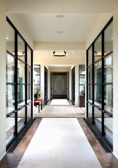 Love this wide hall with windows along each side. #entry