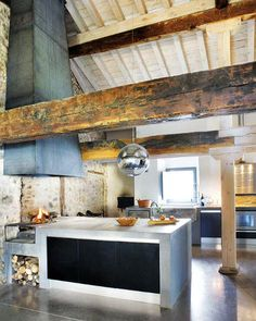 stone wall and beams in the kitchen