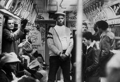 A member of the volunteer crime-fighting organization, the Guardian Angels, patrols a subway car in the 1980s. The organization was both praised and vilified by the media for its efforts.