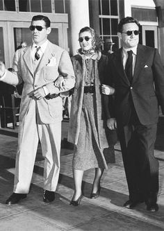 Clark Gable, Myrna Loy, and Spencer Tracy on the set of Test Pilot, 1938