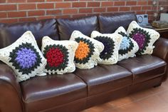 Crochet chunky cushion cover with flower centre.