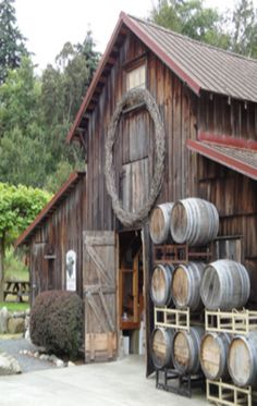 Barn With Old Barrels On Side                                                                                                                                                      More