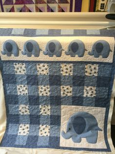 I gave this Pachyderm Parade quilt some extra love when I quilted it for a client. It's adorable.