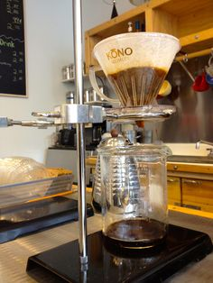 Pour over coffee dripping into a beaker at the Coffee Lab in Evanston. * chicago * cafe * coffee