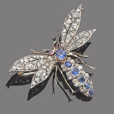 A late 19th century sapphire, ruby and diamond dragonfly brooch