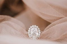 Engagement ring design: oval diamond in an oval halo setting