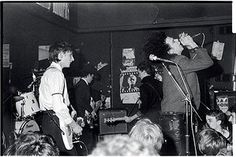 The Birthday Party (visible: Rowland S Howard, Tracy Pew, Mick Harvey and Nick Cave) photographed at the Moonlight Club, West Hampstead, by Bleddyn Butcher on 26 October 1981