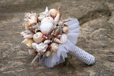 ♡ Beach #wedding #Seashell #bouquet ... For wedding ideas, plus how to organise an entire wedding, within any budget ... https://itunes.apple.com/us/app/the-gold-wedding-planner/id498112599?ls=1=8 ♥ THE GOLD WEDDING PLANNER iPhone App ♥  For more wedding inspiration http://pinterest.com/groomsandbrides/boards/ photo pinned with love & light, to help you plan your wedding easily ♡