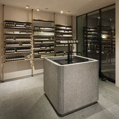 Vincent Van Duysen Architects fits Aesop's Hamburg store with a chunky stone sink
