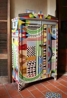 Brightly painted armoir...I LOVE IT! Very African!