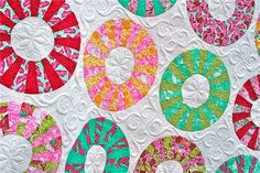 Cartwheels Quilt - LOVE the spirls in the red portions of the dresden
