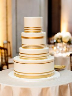 Make a simple wedding cake style look elegantly sophisticated with gold metallic detailing.