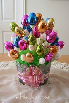 Inexpensive Easter Egg Bouquet Supplies: Eggs - number depends on the size of the container. Here I used 3 pkgs. (36 total) of the big eggs (from Walmart) and 2 of the li...